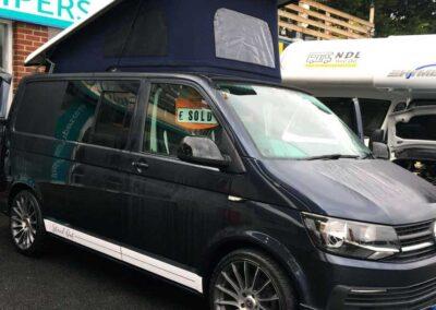 Blue VW Campervan with open PopTop