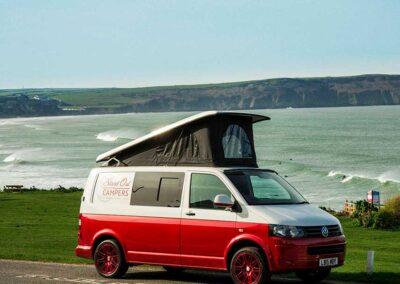 Red VW Campervan seaview
