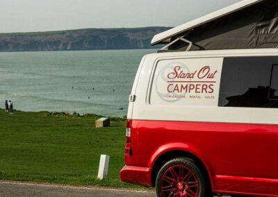Red VW Campervan seaview closeup