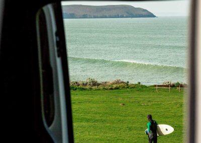 Surfer through VW Campervan Window