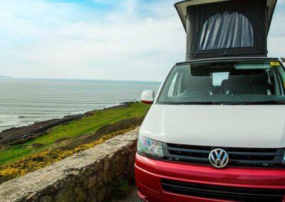 VW Campervan overlooking sea