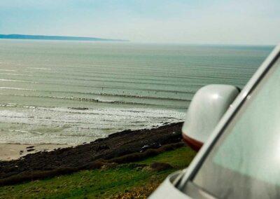 VW Campervan overlooking waves